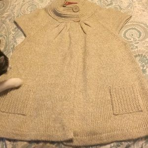 Oatmeal colored cropped sleeved sweater.
